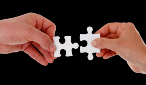 Featured Image Of A Male And Female Hand Each With A Matching Jigsaw Piece Approaching Each Other.
