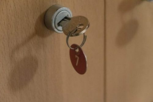 Image Of A Door Tagged Seven Keyhole And Key Numbered Tag.