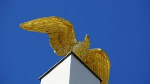 Featured Image Of A Closeup Of A Wings Spread Golden Bird Statue.