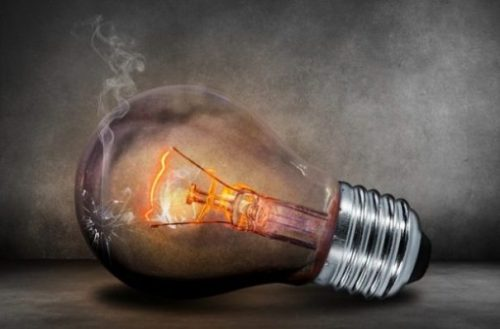 Image Of A Smoking Fiery Lightbulb.
