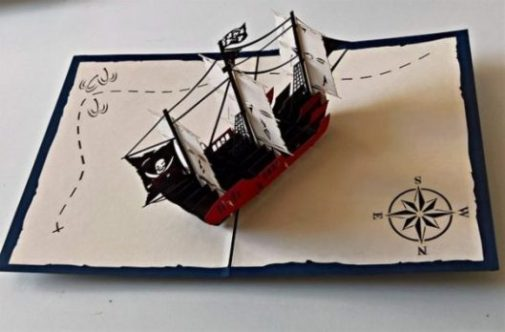Image Of A Toy Pirate Ship On A Treasure Map.