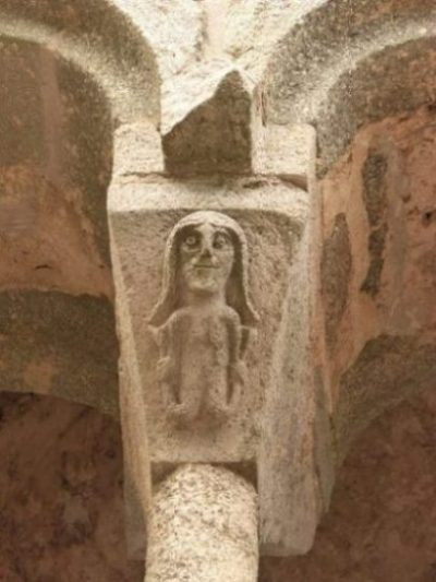 Image Of A Stone Lintel/Portal With A Legendary Siren Carved Upon.