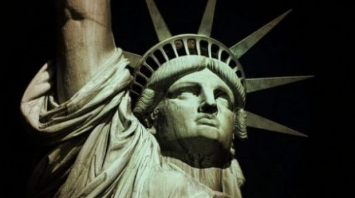 Image Highlighting The Upper Torso And Face Of The Statue Of Liberty.
