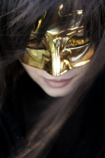 Image Closeup Of A Young Golden Masked Woman.