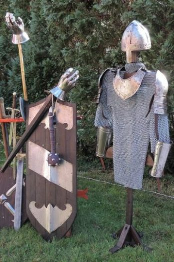 Image Showing Knights Armor Components Displayed And Hanging In Place.