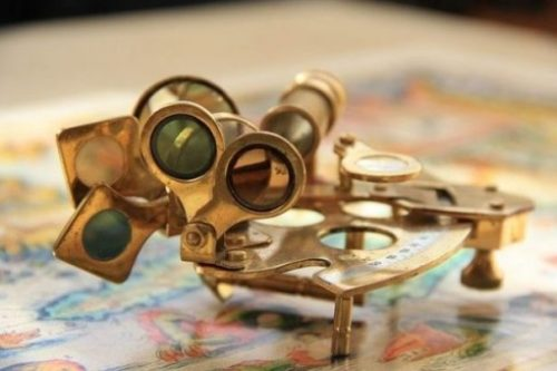 Image Of An Olden Sextant Device.