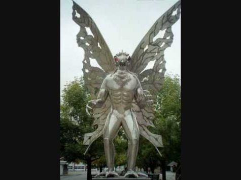 Image Of A Statue Of Mothman.