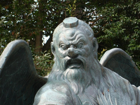 Image Focusing On The Face Of A Tengu Statue.