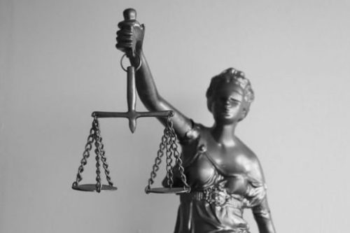 Image Of A Statue Of Our Goddess Of Justice Carrying Scales Aloft.