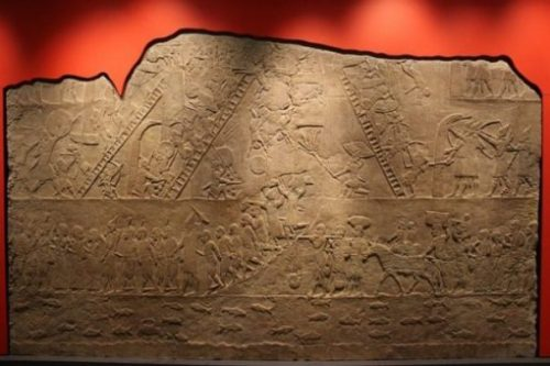 Image Of Yore Sumer Relief Featuring Giant Soldiers Amongst An Army.