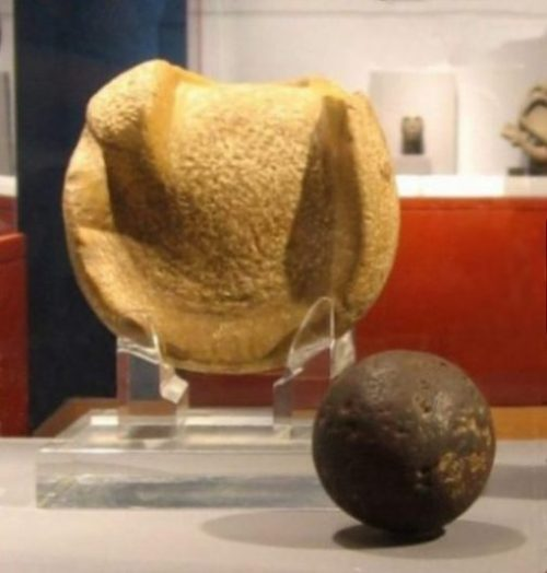 Image Of Ancient Mesoamerican Manopla And Rubber Ball.